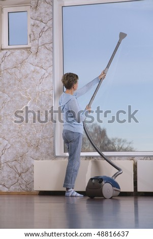 Middle Age Woman with Vacuum Cleaner