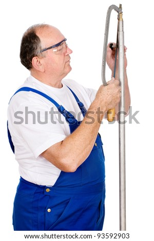 Middle age worker cutting screw on a metal tube, isolated on white background