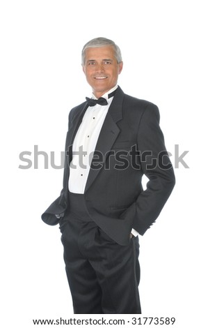 Middle Aged  Adult Male Wearing a Tuxedo with hands in pockets isolated on white