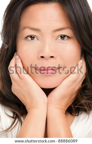 Middle aged asian woman beauty portrait. Closeup of mid age Chinese Asian female model.