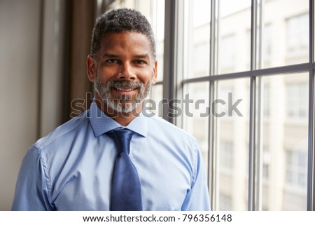 Middle aged black businessman smiling to camera #796356148