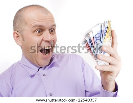 Middle aged business man holding euro money isolated on white
