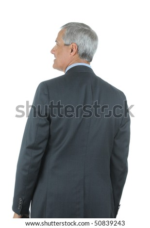Middle Aged Businessman seen from behind and looking to his left isolated over white