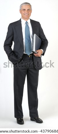 Middle Aged Businessman smiling holding laptop with hand in pocket, vertical format full length
