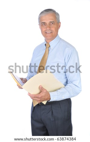 Middle aged businessman standing and holding a manila file folder. Vertical format isolated on white background.