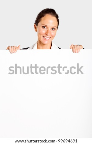 middle aged businesswoman behind white board