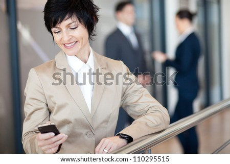 middle aged businesswoman using smart phone