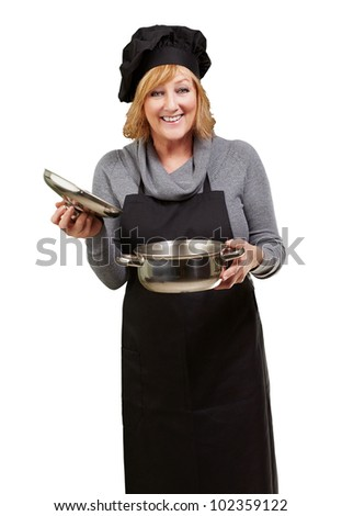 Middle aged cook woman holding a sauce pan over a white background