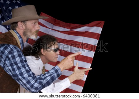 Middle aged country and western cowboy with traditional costume and modern american tycoon man in front of american flag.