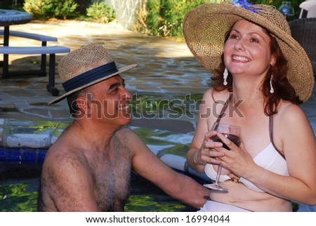 Middle aged couple enjoy relaxing at a spa resort