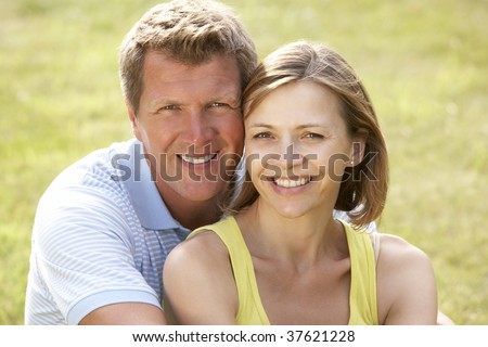 Middle aged couple having fun in countryside