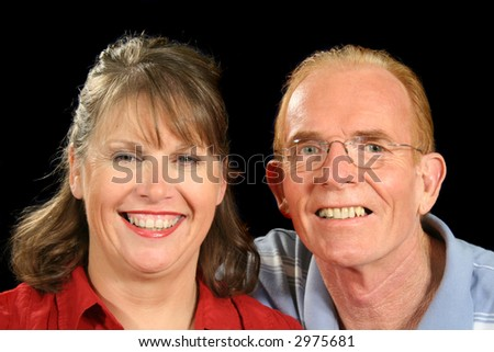 Middle aged couple together smiling.