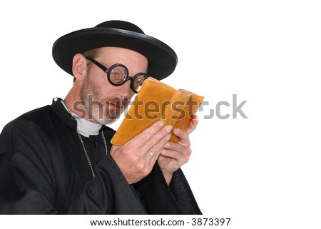 Middle aged devout priest in with bad eye sight.  Religion, christianity, lifestyle, ophthalmology concept - stock photo