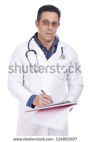 middle aged doctor standing hearing a stethoscope and writing