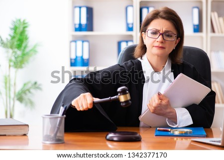 Middle-aged female doctor working in courthouse  Foto d'archivio ©