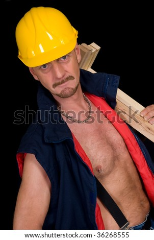 Middle aged handsome male construction worker. Studio shot, black background.