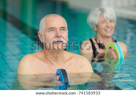 middle aged happy couple in swimming pool #741583933