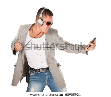Middle aged Hispanic man dances while listening to music