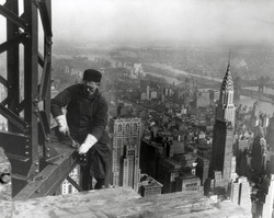 Middle aged iron worker at the Empire State Building construction site, 1930. The Chrysler Building's spire is at right. Photo By Lewis Hine.