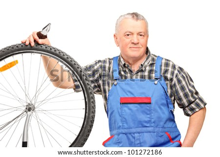 Middle aged male holding pliers and repairing bicycle wheel isolated on white background