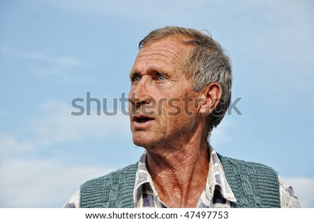 Middle aged male person with interesting gestures