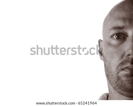 middle aged man bald with stubble and signs of aging. male stare into camera with white copy space