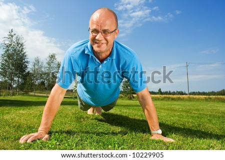 Middle-aged man doing push-ups
