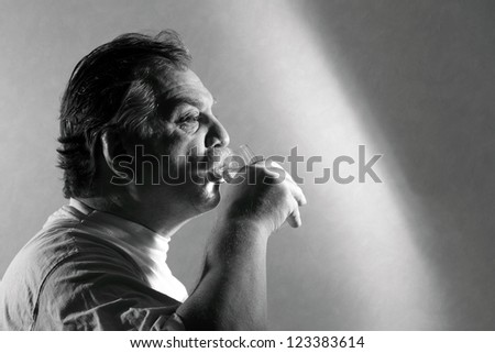 middle aged man drinking water from a glass
