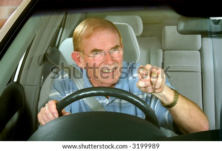 Middle aged man exploding with road rage.
