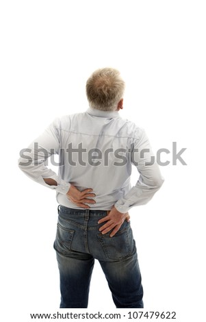 Middle-aged man has back pain. He keeps his back and can be seen from behind.