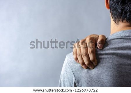 Middle aged man has shoulder pain. with copy space for text #1226978722