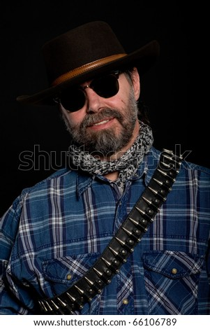 Middle aged man in a cowboy hat. - stock photo