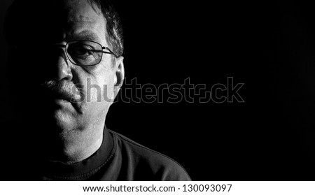 middle-aged man in eyeglasses, black and white