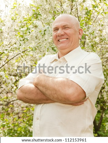 middle-aged man in flowering garden