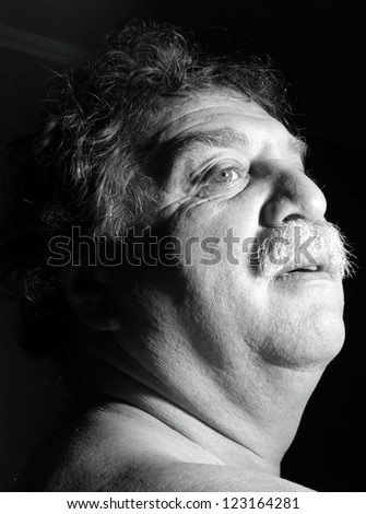 middle-aged man looks up
