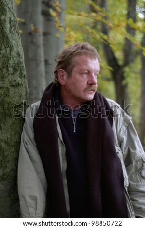 middle aged man outdoors in autumn