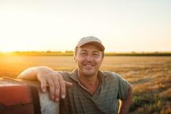 Middle aged man portrait on farmland.