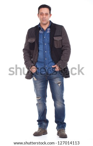 middle aged man standing with his hands on pockets