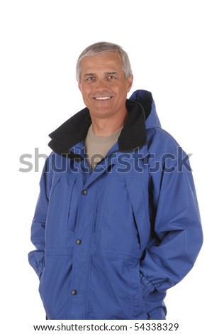 Middle aged man wearing a blue anorak isolated over white. Vertical format from waist up only.