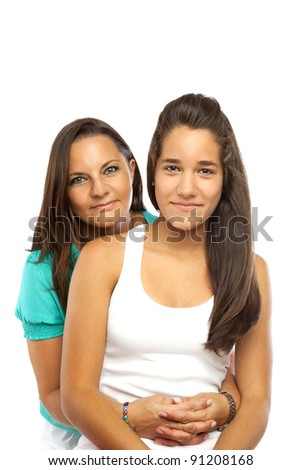 Middle-aged mother hugging her daughter isolated on white background