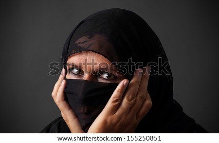 Middle-aged muslim woman hiding her face looking angry #155250851