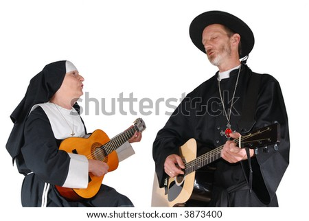 Middle aged nun and priest playing the guitar.  Religion, christianity, lifestyle, entertainment, music, concept