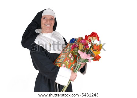 Middle aged  sister, nun with birthday present and flowers.  Religion, christianity, lifestyle,  holiday concept