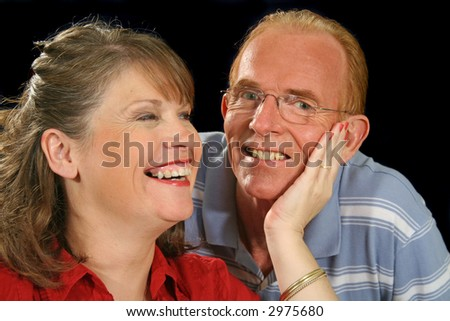 Middle aged wife holding her husband's cheek.