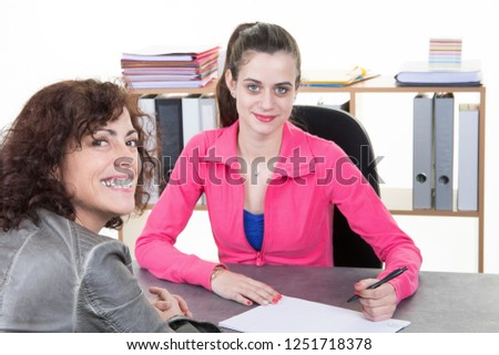 middle-aged woman comes to register insports fitness club #1251718378