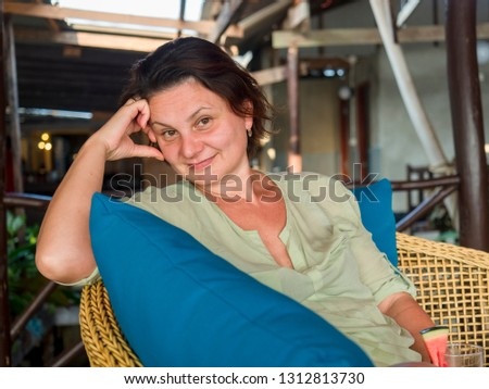 Middle aged woman drinking watermelon smoothie in cafe #1312813730