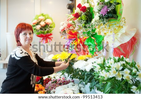 Middle-aged woman in  flower shop