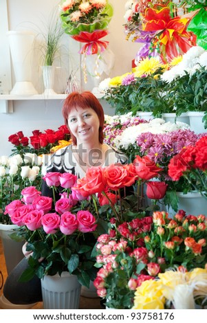 Middle-aged woman in her small  flower shop