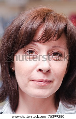 middle-aged woman looks thoughtfully