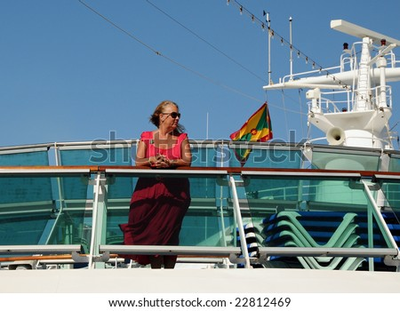 Middle-aged woman on the top deck of a cruise ship